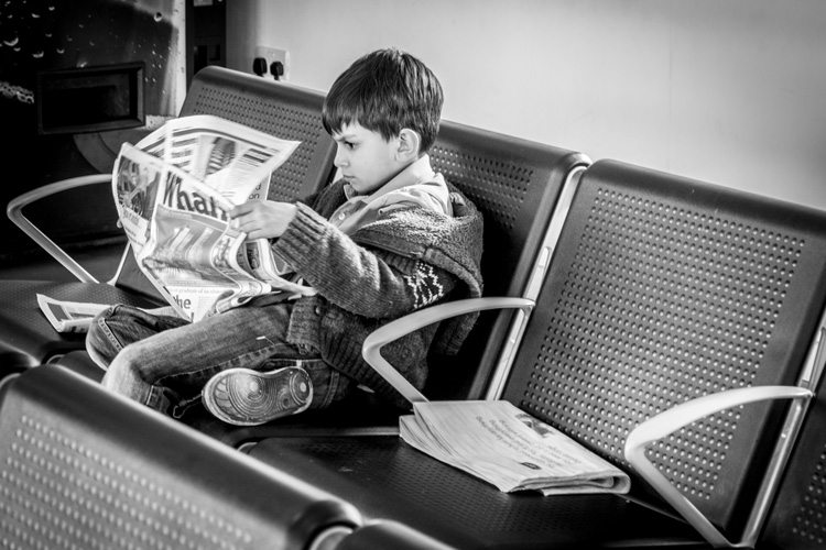 Young intellectual reading the news