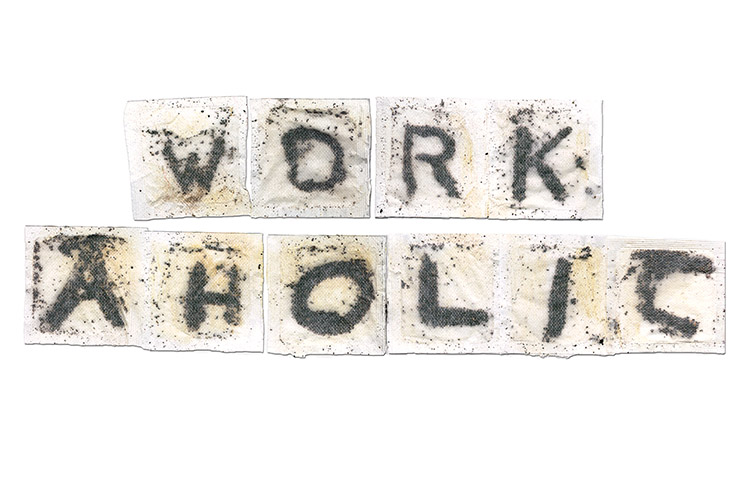 "Square teabags with each teabag showing a letter to spell out ""workaholic"""