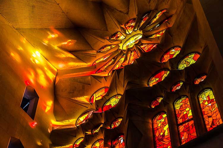 Inside, looking at the amazing roof and colours from the stained glass windows, looking like fire