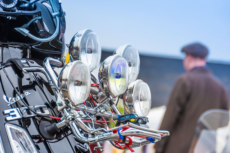 Loads of headlights on a vintage scooter