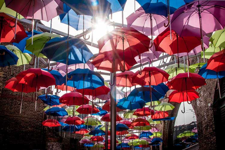 Abstract image of floating umbrellas