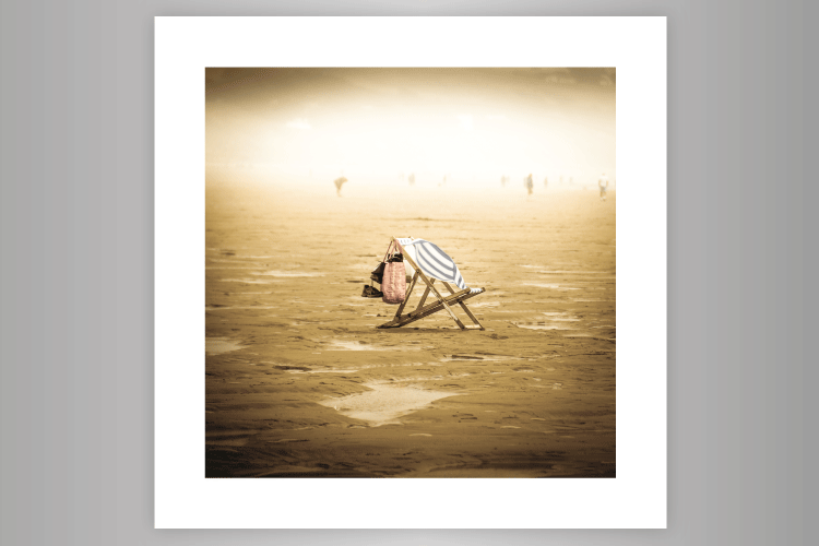 Photograph of deckchair alone and caught by the wind