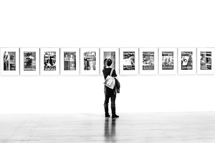 Photograph of a woman alone in an art gallery