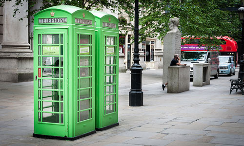 surreal category green telephone boxes on the street